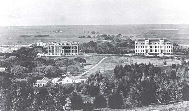 "A very early panorama of Berkeley and the first two university buildings, North and South Halls, on the UC Berkeley campus. UC opened its doors in Berkeley in 1873. South Hall, the left building, still stands proudly on the UC campus. To the west and a little to the north of this building on can see F. K. Shattuck's estate on a dirt road bearing his name. This photo was about five years before Shattuck convinced the Central Pacific Railroad to extend its line into this remote area. Shattuck had been an Alameda County Supervisor and early Mayor of Oakland. Early on he had made a wise investment in the remote real estate we know of as downtown Berkeley. From the book ""Eccentrics, Heroes, and Cutthroats"" by Richard Schwartz. Photo: Courtesy Richard Schwartz"