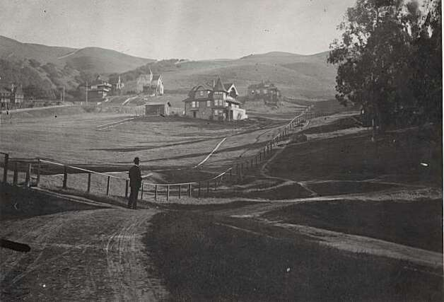 """A man looking up at what would become Hearst Street from somewhere above Oxford Street. This street was the northern boundary of the new University of California. It is most likely that the dirt road running left to right (north to south) in the mid-photo is Euclid Ave. The hills remain empty of houses due to fire hazards and lack of fire insurance offered in the hills. From the book """"Eccentrics, Heroes, and Cutthroats"""" by Richard Schwartz. Photo: Courtesy Richard Schwartz"""