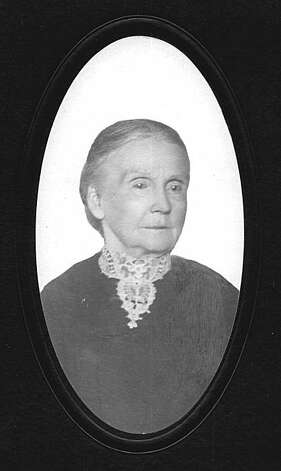 """A photo of Mary Townsend that was kept amongst family photos.  She probably worked for the pioneer family as she was not related to them but was so highly regarded that they kept her in their family photo album.This confirms the esteem Mary was said to be held in with many of her clients, as she is mentioned fondly in their autobiographies as well. She worked for many of Berkeley's best families. Mary Townsend was a cleaning woman and single mother who worked incredibly hard and saved her money to buy real estate. She refused to give up a piece of her shallow lot on Shattuck Avenue to allow a private railway, the Central Pacific, to be laid out. It would have been right up to her window. The fight that ensued--a cleaning woman vs. the County, City and the railroad--lasted decades and Mary became an icon by her determined struggle.  It was said she lay down in front of the first steam train that tried to make it down the new tracks to Shattuck and University. That started the fight that would last decades. The power forces did not realize whom they were dealing with in the stubborn and determined cleaning woman who did not hesitate to hire an attorney to fight for her.  From the book """"Eccentrics, Heroes, and Cutthroats"""" by Richard Schwartz. Photo: Courtesy Richard Schwartz"""