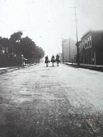 "Men on horseback ride down a dirt-paved and rutted Alcatraz Avenue in an earlier time in Berkeley. Alcatraz was a street where steer were stampeded to market, children ran for their lives and parents protested the insanity of the situation. Roads in early Berkeley were known for being very dusty in summer and so muddy in winter that a flag on a pole was recommended for every wagon so when it sunk into the mud, the flag would make it possible to find it and dig it out. From the book ""Eccentrics, Heroes, and Cutthroats"" by Richard Schwartz. Photo: Courtesy Richard Schwartz"