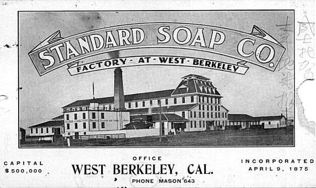 "A post card of the Standard Soap Works right as the factory opened. There are no train tracks on the east side of the building at Third St. They were installed in January 1877, dating this photo as before that time. The post card with Chinese characters written on the margins of the card tells an interesting story. The Chinese characters attempt to help the reader pronounce the name of the company in English. It is likely the Chinese workers of the Works used it as a guide. Chinese workers were not welcomed in many businesses at that time and were hired and fired at the Standard Soap Works depending on the political forces at work at the time. From the book ""Eccentrics, Heroes, and Cutthroats"" by Richard Schwartz. Photo: Courtesy Richard Schwartz"