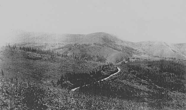 "A  photo of an unnamed road cutting across the Berkeley hills. It is probable this is the Wanger Ranch Road built by Benjamin Boswell. Today we drive on this road through Tilden Park and we know it as Wildcat Canyon Road. In its day it was an immense project jointly paid for by Alameda and Contra Costa Counties. The road enabled farmers and ranchers of Contra Costa County to deliver fruit, produce and livestock to East Bay communities without having to ride south to the end of the Berkeley Hills (around what we know of as San Pablo Dam Rd.) and back north to Berkeley and Oakland. The primitive road up Claremont Canyon was much too steep to safely accomodate heavy wagons laden with fruit, so the new county road was a major step in connecting the two counties and their populations. From the book ""Eccentrics, Heroes, and Cutthroats"" by Richard Schwartz. Photo: Courtesy Richard Schwartz"