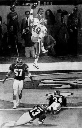 Pontiac Mich Jan 24 1982-----San Francisco 49ers running back Earl Cooper (49) jumps and spikes the ball after a second quarter touchdown pass reception from 49ers quarterback Joe Montana in Super Bowl XVI against the Cincinnati Bengals Sunday.