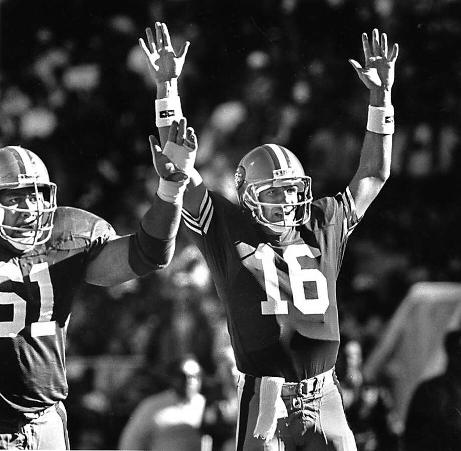 San Francisco 49ers Joe Montana and Jesse Sapolu signal a touchdown in their win over the Eagles Sept 24, 1989.  Photo: Mike Maloney