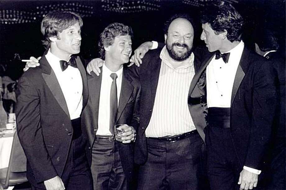 Adult actor and director John Leslie, who died from an apparent heart attack at his Mill Valley home at the age of 65 Sunday, celebrates with colleagues at the Adult Film Association Awards circa 1980. Leslie, born John Nuzzo, appeared in more than 300 adult films and directed adult films for more than two decades. (L-R) Richard Pacheco, Ricky Frazier, Anthony Spinelli, John Leslie. Photo: Courtesy Howie Gordon