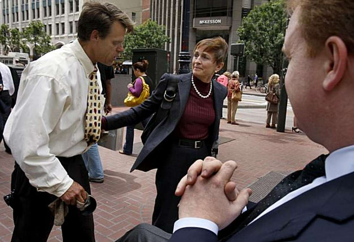 Jill Sideman wishes shoeshine man Larry Moore (left) luck after giving him a tip and a hug at Market and New Montgomery streets in San Francisco, Calif., on Thursday, June 4, 2009.