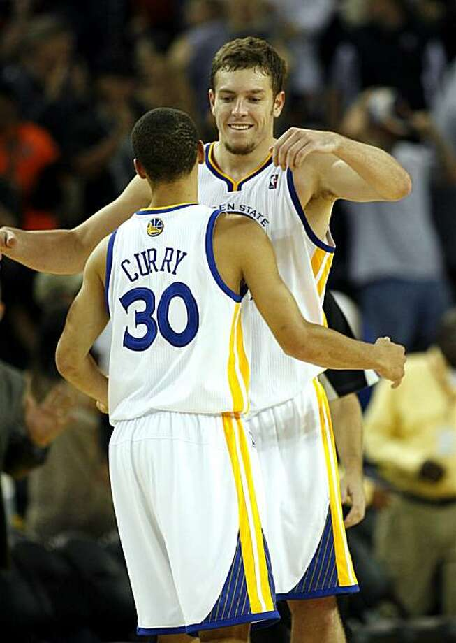 The Golden State Warriors' David Lee and Stephen Curry celebrate their opening night win over the Houston Rockets 132-128 in an NBA  basketball game, Wednesday, Oct. 27, 2010 in Oakland, Calif. Photo: Dino Vournas, AP
