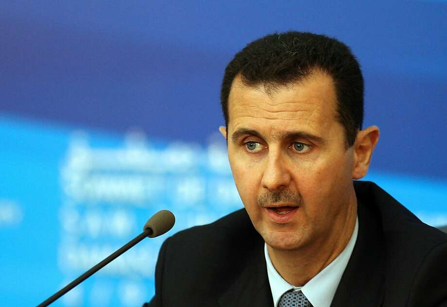 Syrian President Bashar al-Assad speaks during a joint press conference with his French counterpart Nicolas Sarkozy, Turkish Prime Minister Recep Tayyip Erdogan and Qatar's Emir Sheikh Hamad bin Khalifa al-Thani (not seen) following their meeting in Damascus on September 4, 2008. Assad said today a list of proposals has been sent to Israel via Turkish mediators aimed at laying the groundwork for direct peace talks between the two foes. Sarkozy, who wrapped up a landmark visit to Syria, hailed the work of Turkey in mediating the talks and said France was set to give any help required for direct peace negotiations. AFP PHOTO/AWAD AWAD (Photo credit should read AWAD AWAD/AFP/Getty Images) Photo: Awad Awad, AFP/Getty Images