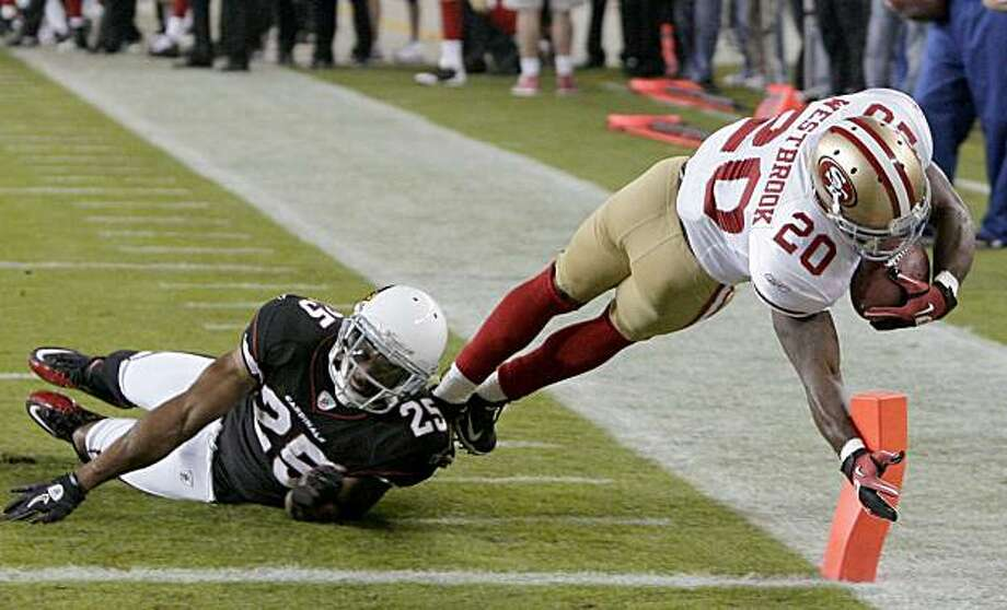 San Francisco 49ers' Brian Westbrook (20) dives for the end zone as he is tackled by Arizona Cardinals' Kerry Rhodes (25) during the first quarter of an NFL football game Monday, Nov. 29, 2010, in Glendale, Ariz. Westbrook was ruled out just short of thegoal line. Photo: Ross D. Franklin, AP