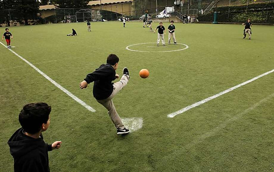 Gavin Hill, a student at Pacific Boychoir Academy, in Oakland, kicks the ball during a kickball game at Beach Playfield in Piedmont, Ca. on Wednesday, March 16, 2011. The City of Piedmont is set to approve the construction of a big sports complex at Blair Park along Moraga Avenue in Piedmont. Photo: Michael Macor, The Chronicle
