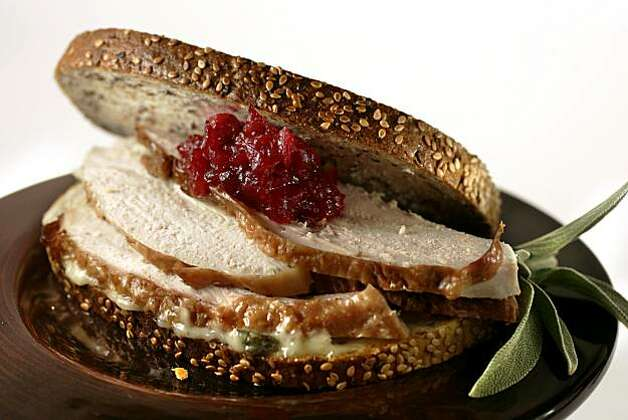 Turkey-Cranberry Relish Sandwich features mayonnaise punched up with sage and roasted garlic, and cranberries enlivened with figs. Photo: Craig Lee, SFC