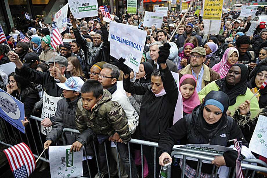 """Protesters gather at the """"Today, I Am A Muslim, Too"""" rally to protest against a planned congressional hearing on the role of Muslims in homegrown terrorism, Sunday, March 6, 2011 in New York. The chairman of the House Homeland Security Committee, Rep. Peter King, R-N.Y., says affiliates of al-Qaida are radicalizing some American Muslims and that he plans to hold hearings on the threat they pose to the U.S. Photo: Henny Ray Abrams, AP"""
