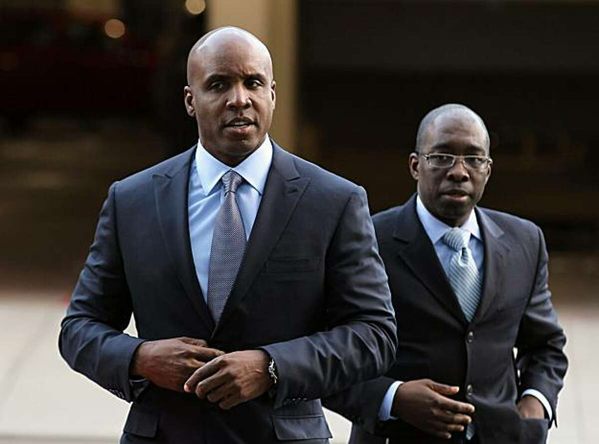 SAN FRANCISCO - MARCH 01: Former Major League Baseball player Barry Bonds (L) arrives for an arraignment hearing on March 1, 2011 in San Francisco, California. Barry Bonds and his former trainer Greg Anderson are appearing for an arraignment hearing ahead of a perjury trial that is expected to begin later in the month. (Photo by Justin Sullivan/Getty Images) ***BESTPIX***
