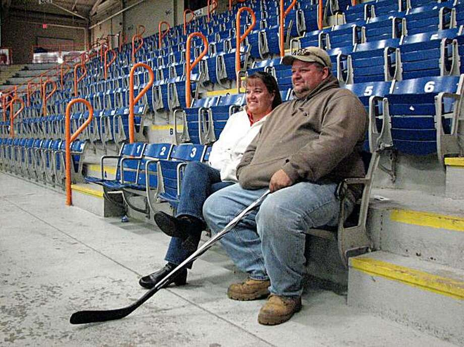 In Maine, the hockey rink is a parental gathering point just like soccer pitches are in California. Here, Lisa Lauzier and Jeff Buiniskas watch their nine-year-old son practice at the  Androscoggin Bank Colisée in Lewiston. She supports same sex marriage, he is leaning towards it. Buiniskas bought their son a new stick today. He is holding his old one. Photo: Joe Garofoli, San Francisco Chronicle