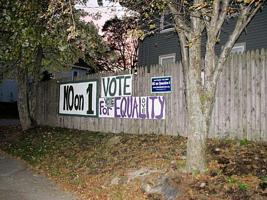 Compared to California's contentious Proposition 8 campaign in 2008, there are relatively few signs in Maine's same sex marriage debate. Here is a homemade sign on a fence near Bangor. Photo: Joe Garofoli, San Francisco Chronicle