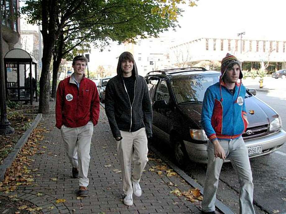 Rialto (Riverside County) resident -- and same sex marriage supporter and volunteer vacationer --  Gabe Gonzalez (right, with hat) escorts two Bates College students Gardiner Nardini and Hunter Archibald to vote early at Lewiston City Hall in Maine. Photo: Joe Garofoli, San Francisco Chronicle