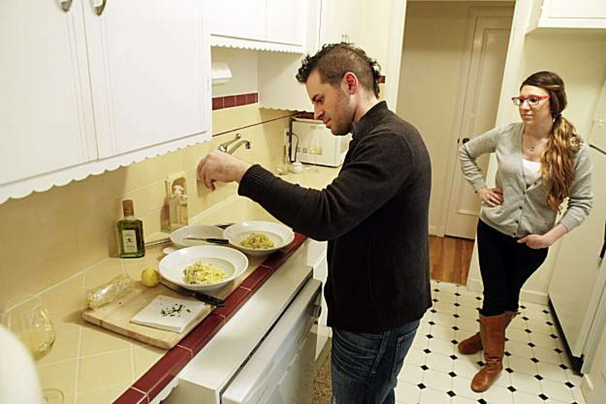 SPQR chef Matt Accarrino garnishes pasta as he and his girlfriend, Catherine Schimenti of Bourbon Steak, make dinner on Monday, February 21, 2011, in their San Francisco, Calif., home.