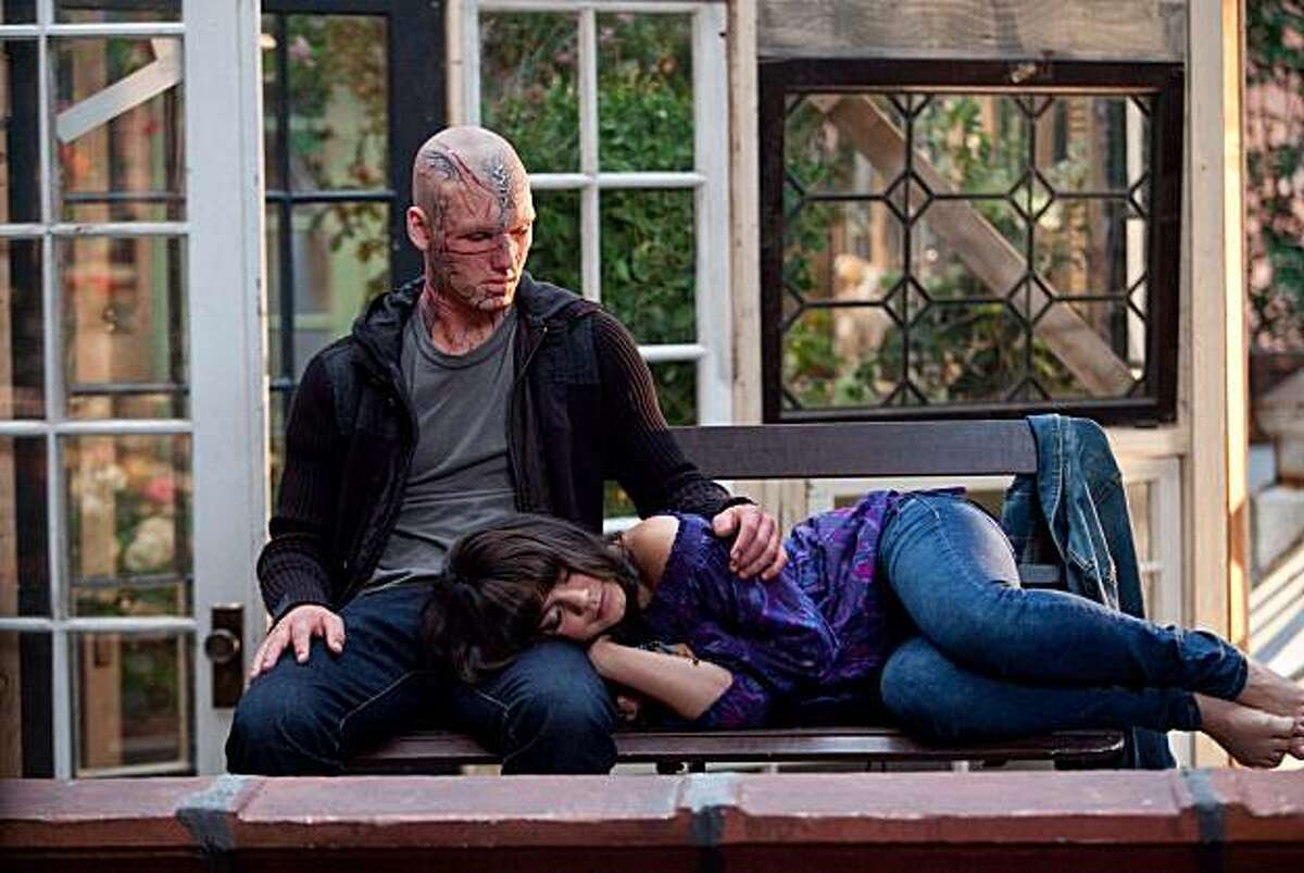 In this film publicity image released by CBS Films, Alex Pettyfer, left, and Vanessa Hudgens are shown in a scene from