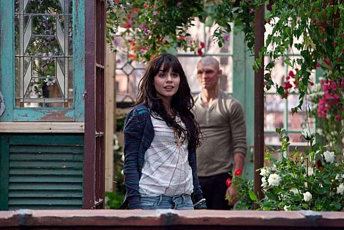 In this film publicity image released by CBS Films, Alex Pettyfer, background, and Vanessa Hudgens is shown in a scene from