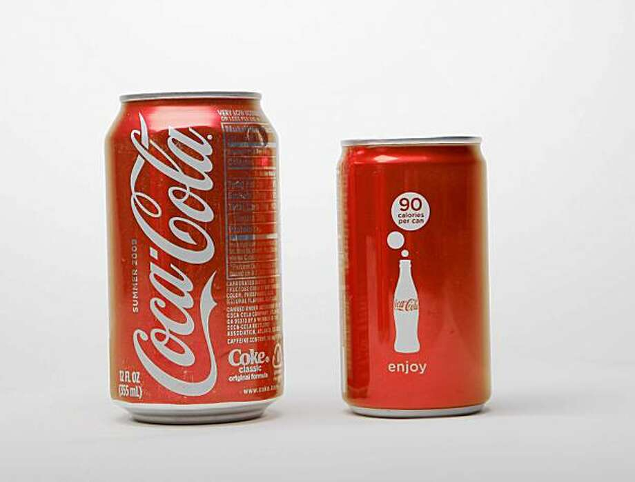 A little happiness in a stylish new package is coming soon to your refrigerator. Coca-Cola today introduced a new 90-calorie sleek mini can to give consumers a better way to manage their calories. (Photo: Business Wire) Photo: Business Wire