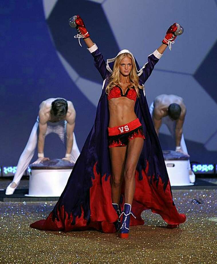 Model Erin Heatherton walks on stage during the 2010 Victoria's Secret Fashion Show at the Lexington Armory in New York November 10, 2010. The show will be broadcast November 30, 2010 on CBS. Photo: Timothy A. Clary, AFP/Getty Images