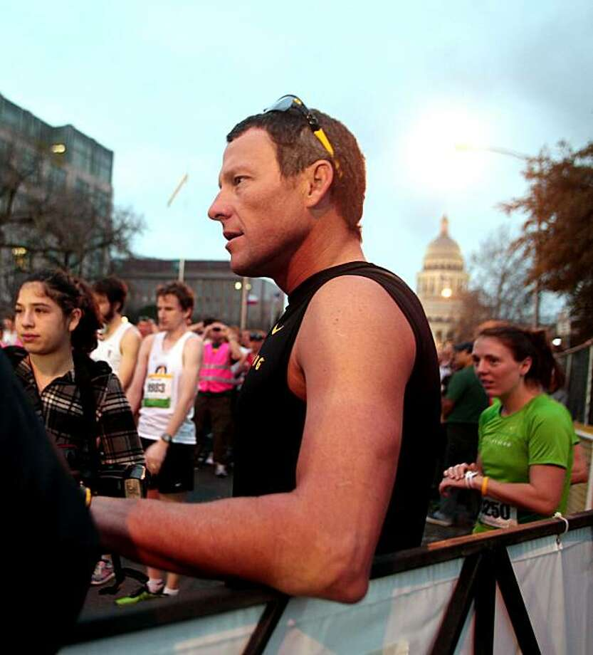 Lance Armstrong waits for the Live Strong Austin Marathon 2011 to start in front of Austin Capitol Sunday morning, Feb. 20, 2011 in Austin, Texas. Armstrong announced his retirement from cycling on Tuesday, for good this time, he says. Photo: Mary Kang, AP