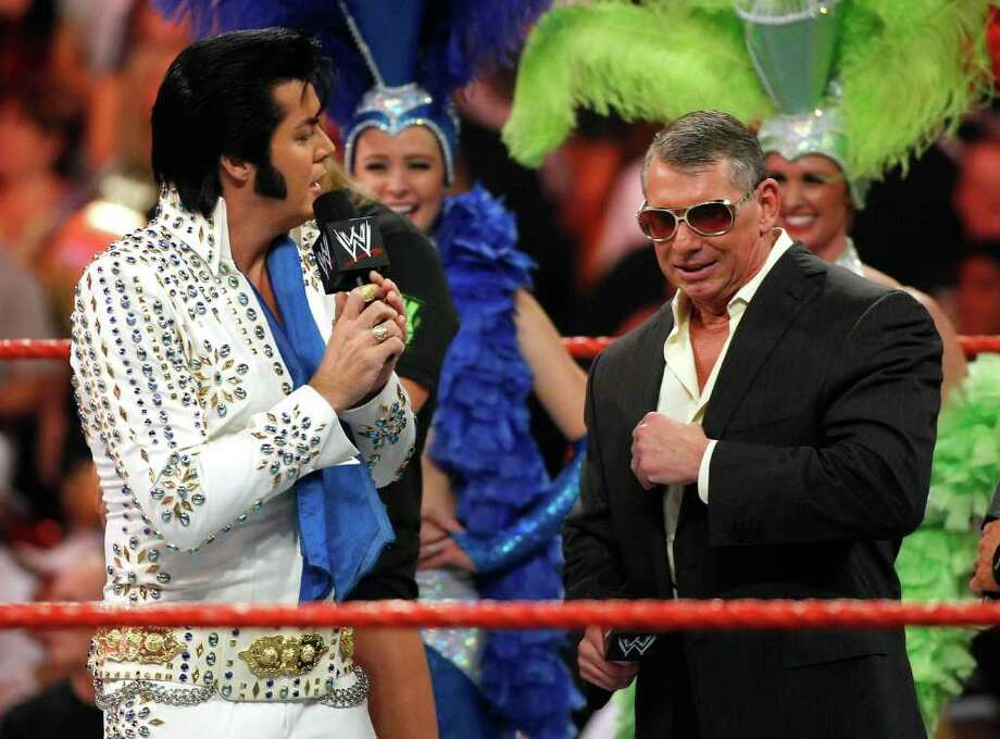 WWE chairman Vince McMahon, right, pictured celebrating his 64th birthday during a Monday Night Raw show in Las Vegas, Nev., in 2009, was spotted driving a new Bentley in Greenwich last week. (Photo by Ethan Miller/Getty Images) Photo: Ethan Miller, ST / 2009 Getty Images