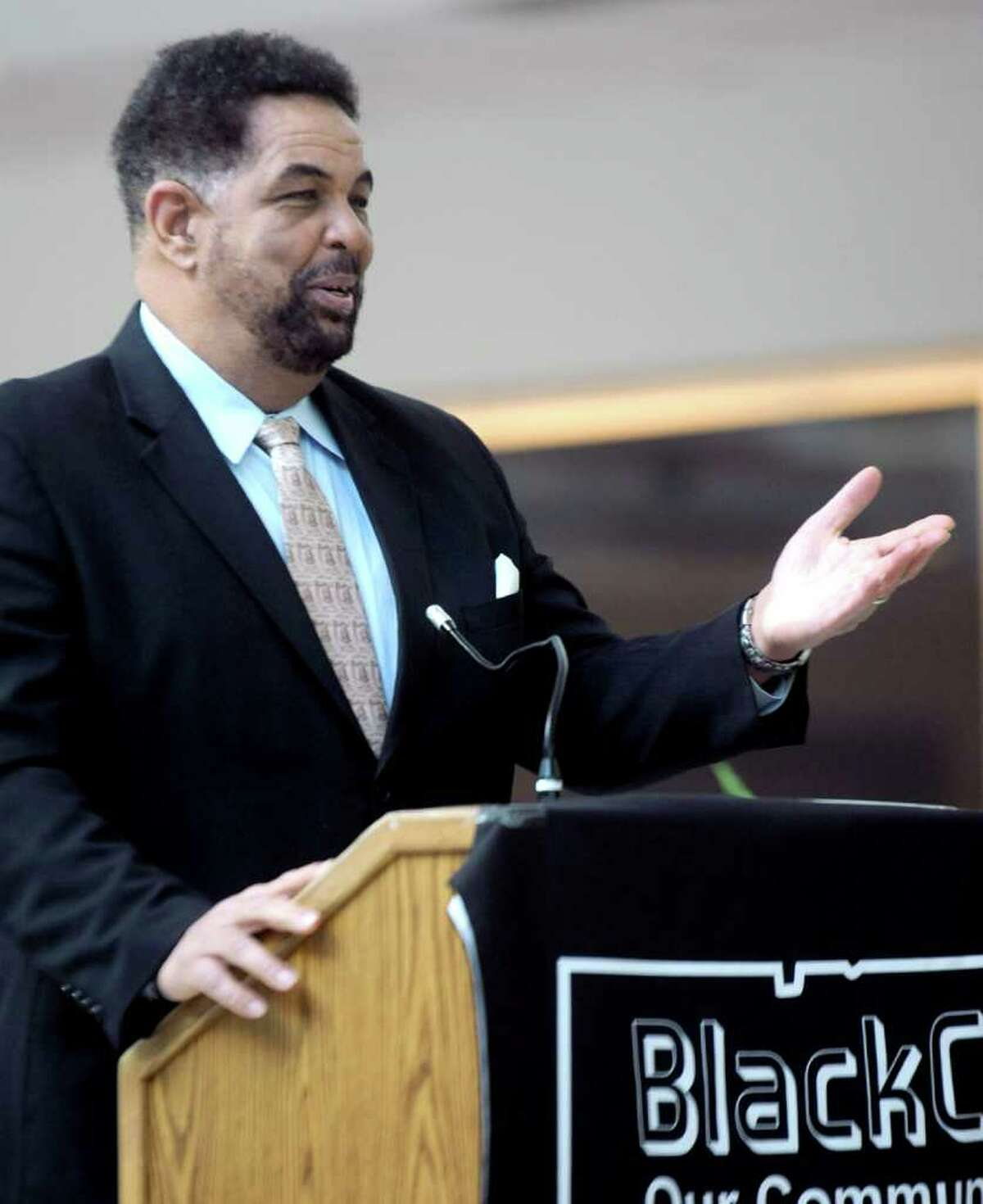 Former Stamford High School Principal and Founder of Rites of Passage Rodney Bass speaks after being presented the Stamford ICON Award during the 2012 MLK All about Education Day at the University of Connecticut's Stamford campus on Saturday, January 14, 2012.