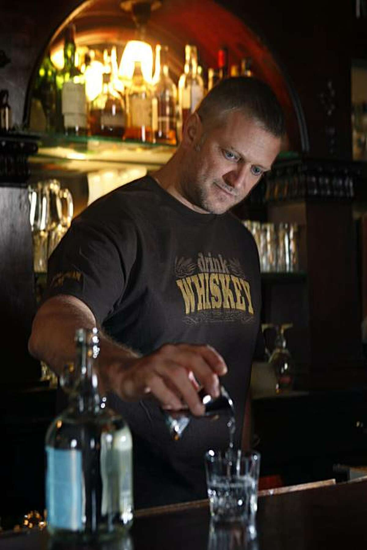 Elixir offers several moonshine including Marco K. Spirits' Doubled & Twisted IPA Whiskey Light which bar owner H. Joseph Ehrmann is pouring on Wednesday, February 10, 2010, in San Francisco, Ca.