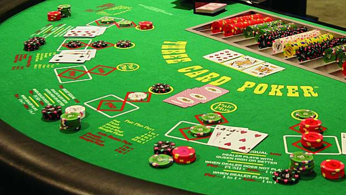 An image of a three-card poker table.