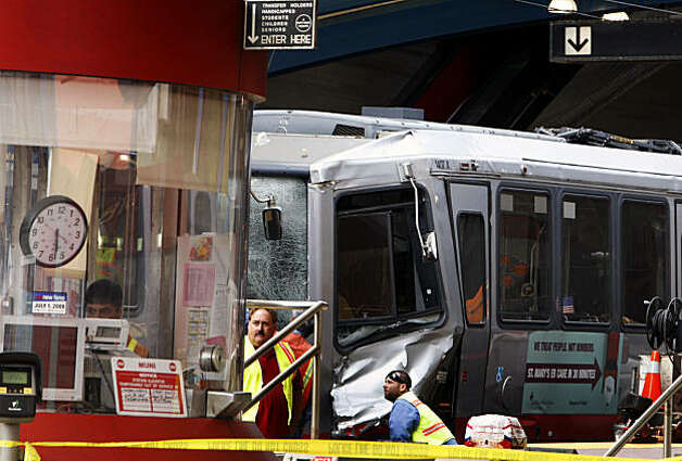 Muni personal look over the two trains involved in an afternoon collision at the West Portal Station July 18, 2009. Nine of the injured with critical injuries were transported to San Francisco General Hospital Saturday; other local hospital treated over thirty other victims. Photo: Lance Iversen, The Chronicle