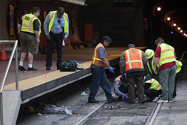 Muni workers inspect the rail track after two Muni trains collided at the West Portal Station in San Francisco, Calif. Saturday, July 18, 2009. Photo: Stephen Lam, The Chronicle
