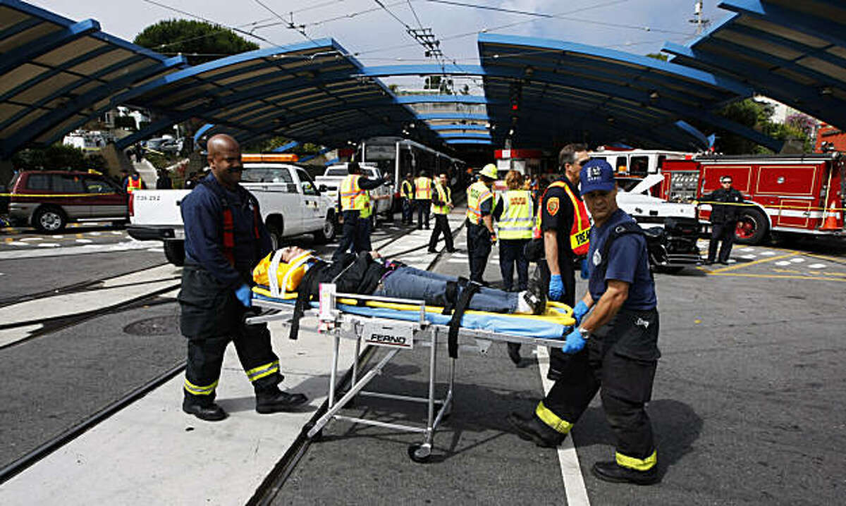 Emergency workers tend to people involved in a two train MUNI crash at the West Portal Station on Saturday, July 18, 2009.