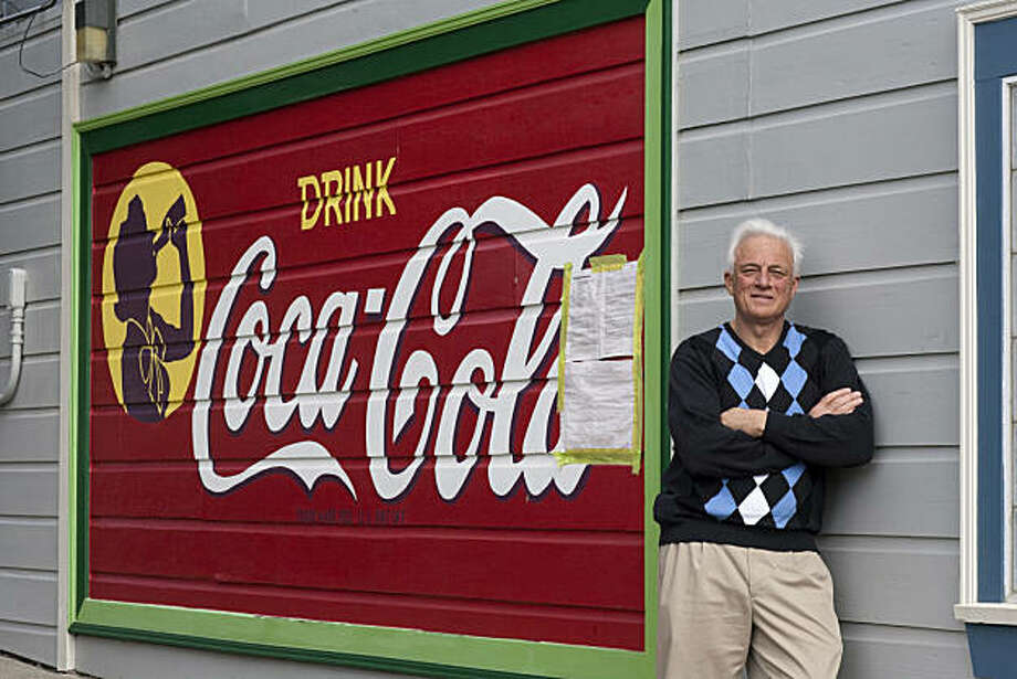 Richard Modolo stands in front of a Coca-Cola sign that was painted on the side of his house in the early 1950's when his home was the site of a mom and pop grocery store on February 23, 2011 in San Francisco, Calif.  Photograph by David Paul Morris/Special to the Chronicle Photo: David Paul Morris, Special To The Chronicle