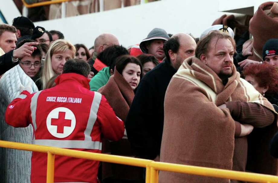 Passengers of the Costa Concordia, a luxury cruise ship that ran aground off the coast of Tuscany, arrive on a ferry in Porto Santo Stefano, Italy, Saturday, Jan. 14, 2012. The luxury cruise ship ran aground off the coast of Tuscany, gashing open the hull and taking on water, forcing some 4,200 people aboard to evacuate aboard lifeboats to a nearby island early Saturday, said Coast Guard Cmdr. Francesco Paolillo. Photo: Gregorio Borgia, AP / AP