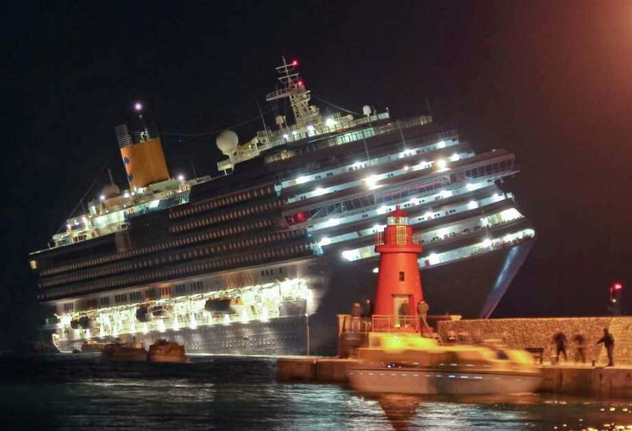 Rescuers surround the luxury cruise ship Costa Concordia after it ran aground off the coast of Isola del Giglio island, Italy, gashing open the hull and forcing some 4,200 people aboard to evacuate aboard lifeboats to the nearby Isola del Giglio island, early Saturday, Jan. 14, 2012. About 1,000 Italian passengers were onboard, as well as more than 500 Germans, about 160 French and about 1,000 crew members. Photo: Giorgio Fanciulli, AP / giglionews.it