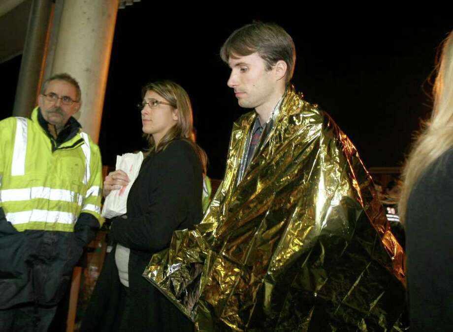 A survivor of the luxury cruise ship Costa Concordia, which ran aground near the tiny Tuscan island of Giglio, Italy, arrive at the harbor, in Marseille, southern France, Saturday, Jan. 14, 2012. Photo: Claude Paris, AP / AP