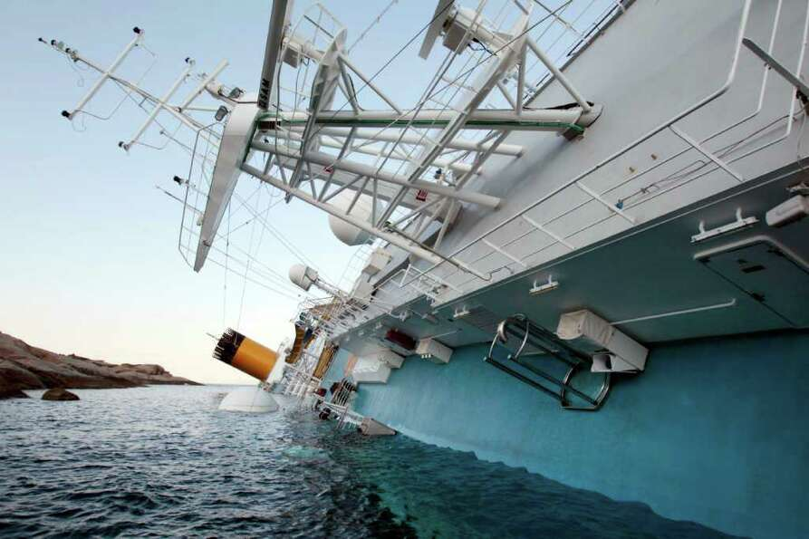 The luxury cruise ship Costa Concordia leans on its side after running aground the tiny Tuscan islan