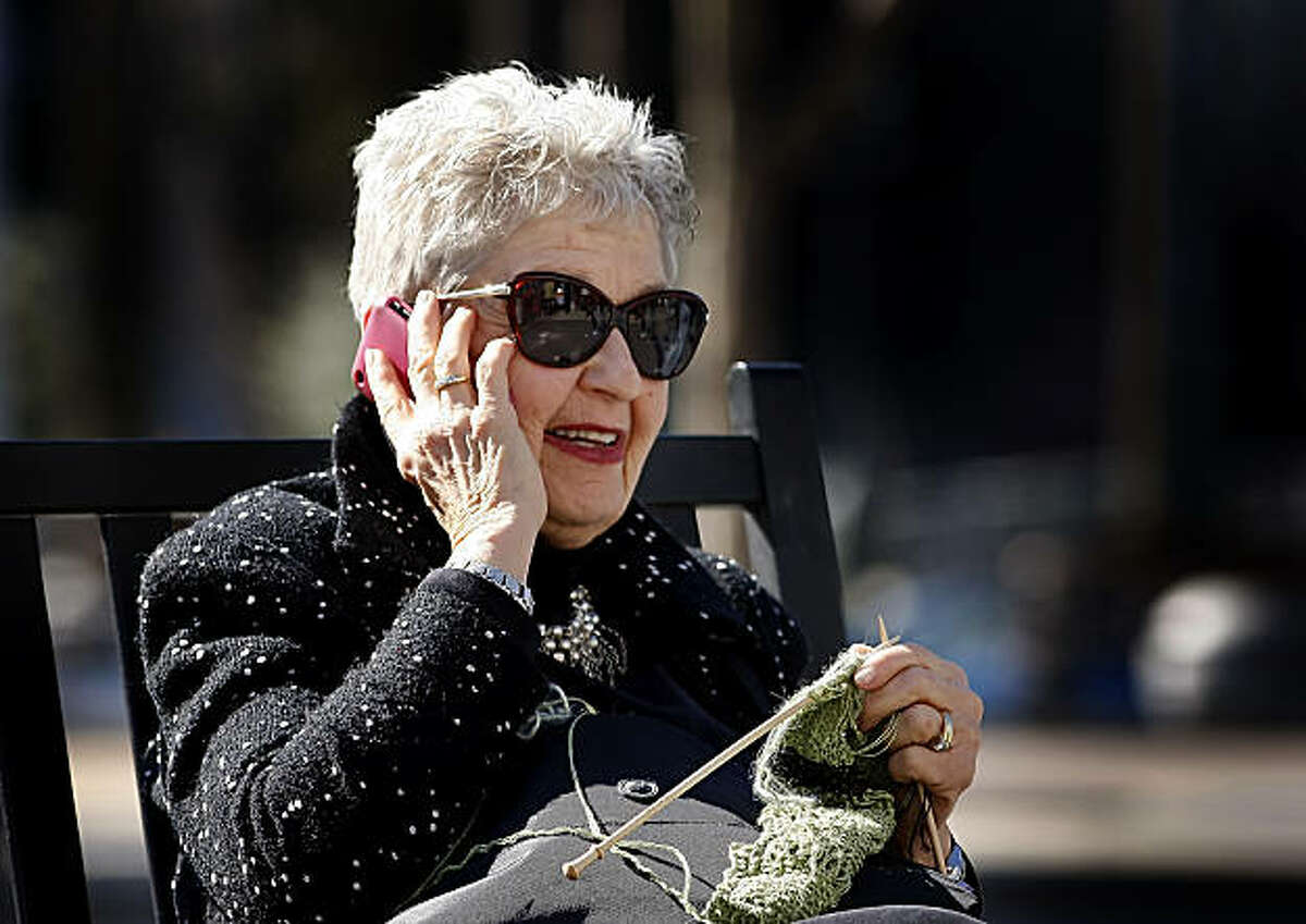 Lois Jacobs , 67 years old, calls Michigan for knitting support after making a mistake on her scarf as she knits in the sun at the Ferry Building, Tuesday Feb. 22, 2011, in San Francisco, Calif. A new study published in JAMA shows that cell phones do in fact have an affect on brain activity, but it's unclear if it's a dangerous effect or not.