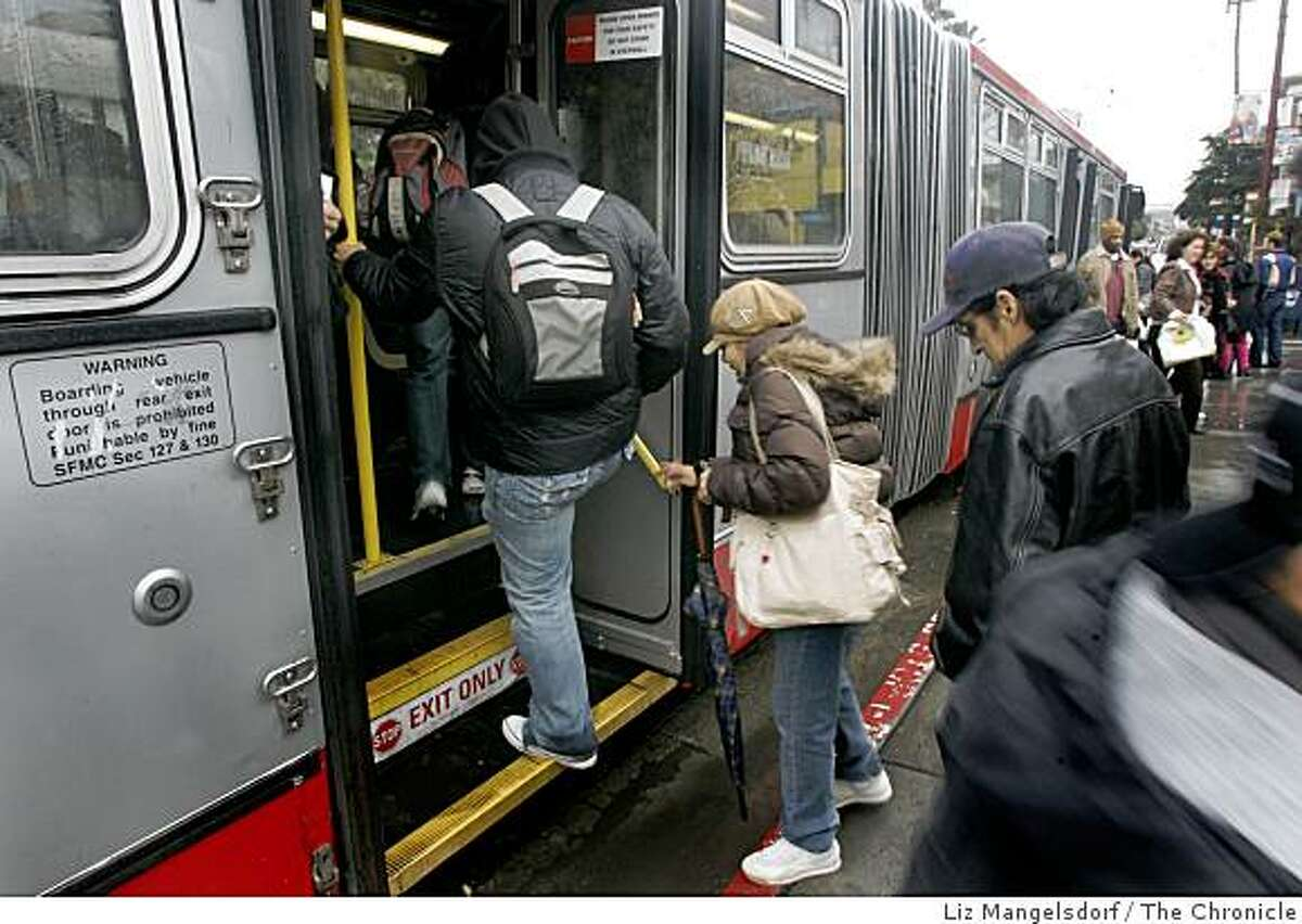 Muni riders board a bus at 16th and Mission Streets from the back, even though signs say it is illegal to board the bus from the back doors. Story is on how MUNI is not collecting all the fares that it could.
