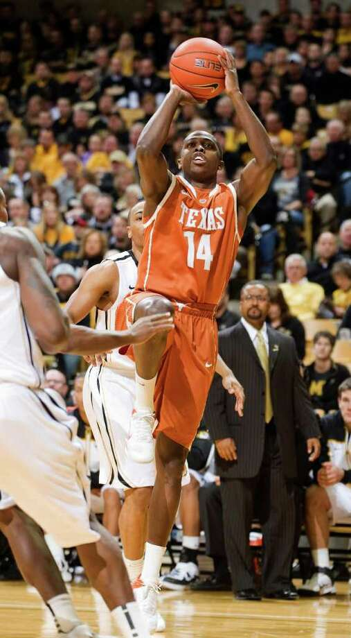 Texas' J'Covan Brown, right, shoots two of his game-high 34 points past Missouri's Matt Pressey, back, during the first half of an NCAA college basketball game Saturday, Jan. 14, 2012, in Columbia, Mo. Missouri won the game 84-73. (AP Photo/L.G. Patterson) Photo: L.G. PATTERSON, Associated Press / FR23535 AP