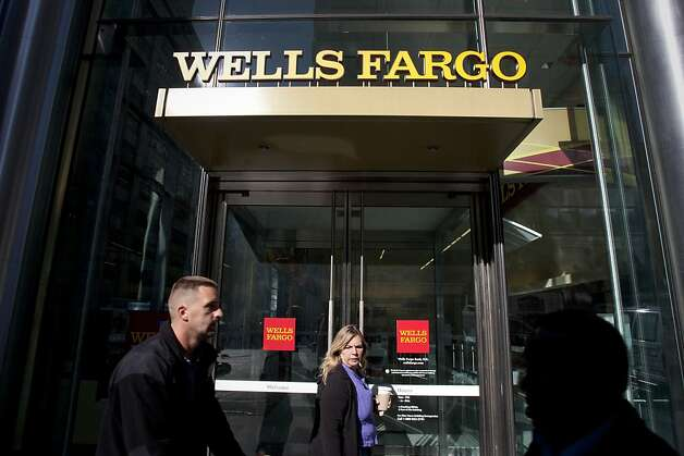 Pedestrians pass in fron of a Wells Fargo & Co. bank branch in New York, U.S., on Monday, Oct. 17, 2011. Wells Fargo, the largest U.S. home lender, posted a 22 percent gain in third-quarter profit as better credit quality eased pressure on the bank's reserves. Photographer: Scott Eells/Bloomberg Photo: Scott Eells, Bloomberg