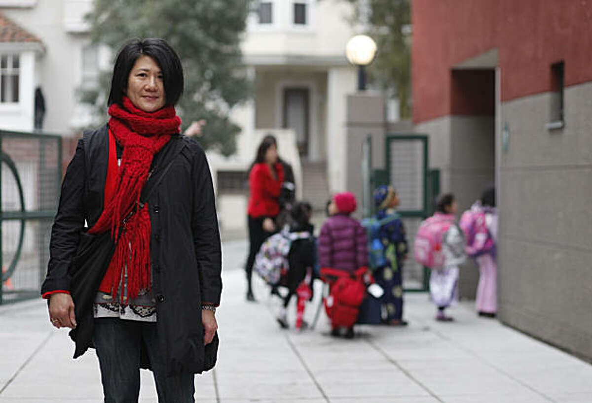 Deborah Kwan stands for a portrait after dropping her two children at Alice Fong Yu elementary on Friday Feb. 18, 2011 in San Francisco, Calif. There has a been a debate over weather or no mayoral candidates will send their kids to public school or not. Kwan said if they opt not to send their kids to public school they are likely to loose her vote.