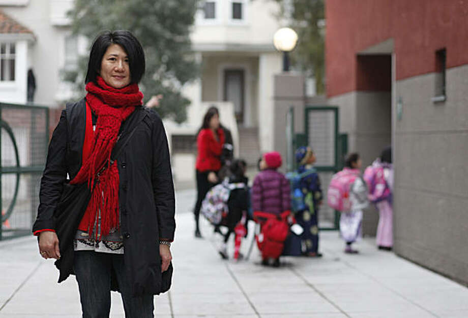 Deborah Kwan stands for a portrait after dropping her two children at Alice Fong Yu elementary on Friday Feb. 18, 2011 in San Francisco, Calif.  There has a been a debate over weather or no mayoral candidates will send their kids to public school or not. Kwan said if they opt not to send their kids to public school they are likely to loose her vote. Photo: Mike Kepka, The Chronicle