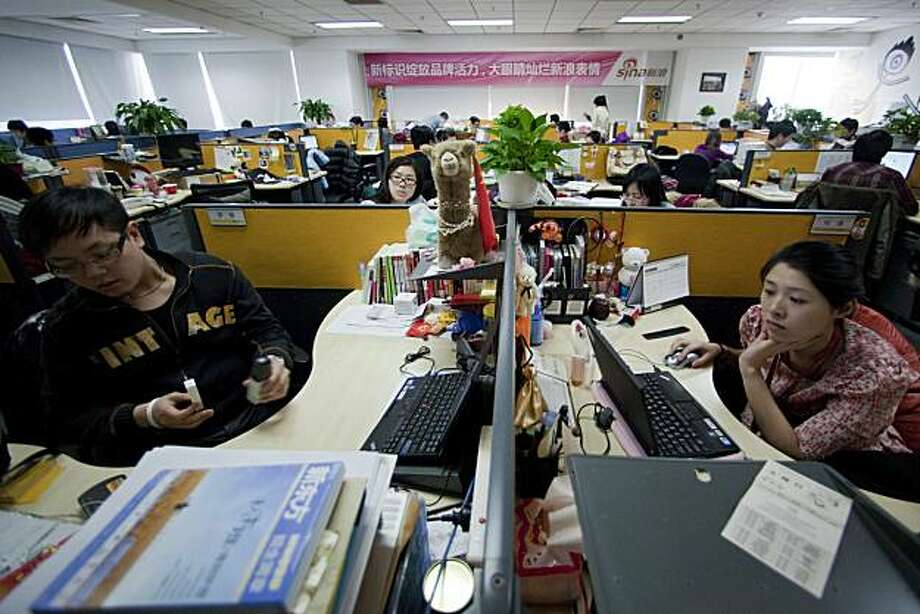 Employees of Sina Corp. work in the Weibo micro blogging division at the company's headquarters in Beijing, China, on Saturday, Feb. 12, 2011. Ye Fangzhao, a 31-year-old freelance brochure editor for auto companies, abandoned his Twitter account a year ago to start using Sina Weibo, a Chinese equivalent. Sina Corp., China's third-most visited Internet portal, is targeting people like Ye to win more attention from China's 450 million Internet users. Photographer: Nelson Ching/Bloomberg Photo: Nelson Ching, Bloomberg