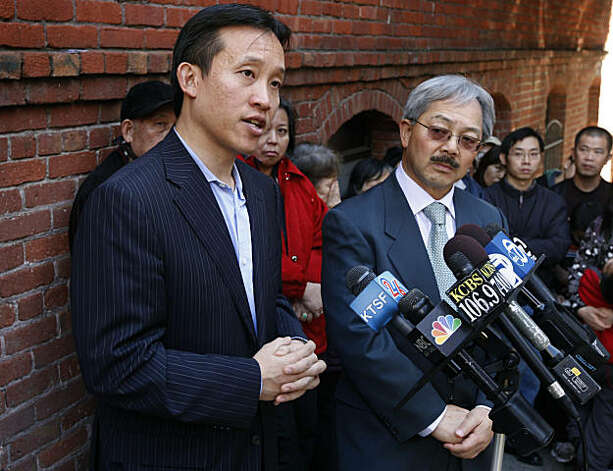 Board of Supervisors President David Chiu (left) and Mayor Ed Lee comment after touring the fire-damaged apartment building at 920 Montgomery Street in San Francisco on Saturday. The two-alarm blaze that broke out early New Year's Day displaced 48 residents. Photo: Paul Chinn, The Chronicle