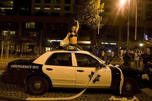 A woman dances on top of a San Francisco police car as Giants fans celebrate the World Series win on King Street between 3rd and 4th Street in San Francisco, Calif., on Monday, November 1, 2010 Photo: Douglas Zimmerman, Courtesy To The SF Gate