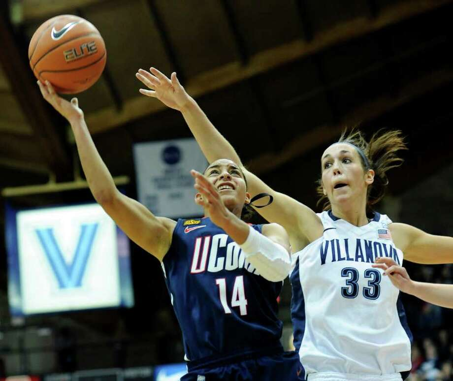 Connecticut's Bria Hartley (14) shoots over Villanova's Laura Sweeney (33) in the first half of an NCAA college basketball game on Saturday, Jan. 14, 2012, in Villanova, Pa. (AP Photo/Michael Perez) Photo: Michael Perez/Associated Press / FR168006 AP