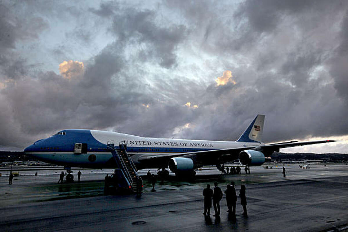 Air Force One sits on the tarmac under partly cloudy skies as the rain took a brief break for the Preident's arrival. President Barack Obama arrived at San Francisco International airport, on Thursday Feb. 17, 2011, for a one day visit with local business leaders in the fields of technology and innovation.
