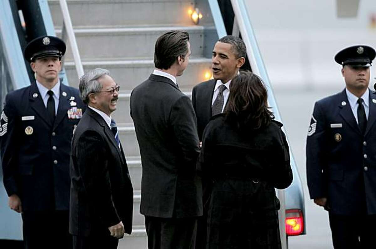 President Obama, greets local politicians, San Francisco Mayor Ed Lee, Lt. Governor Gavin Newsom and State Attorney General Kamala Harris, upon his arrivval aboard Air Force One, at San Francisco International airport, on Thursday Feb. 17, 2011, for a one day visit with local business leaders in the fields of technology and innovation.